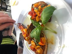Flavoursome tomatoes and olive oil bruschetta