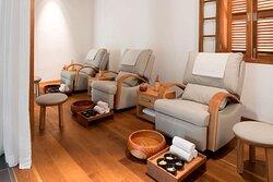 View of three foot massage chairs at Avani Spa