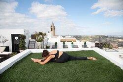 Rooftop yoga overlooking views of Vejer de la Frontera