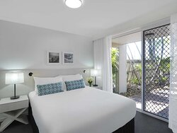 Interior view of bedroom in One Bedroom Suite with terrace