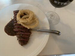 """""""220g Signature Black Angus sirloin with onion rings"""""""