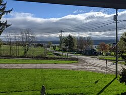 View from private second story balcony overlooking Seneca Lake and quiet homesteads.