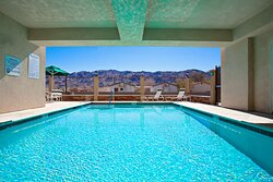 Enjoy the views and escape the heat by our Swimming Pool