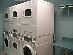 Convenient guest laundry with 2 washers and 4 dryers.