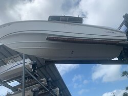27' Boston Whaler cleaned after hours were spent in removing barnacle build-up from owner having left vessel sitting in tropical waters for an extended period of time with no hull protection.. i.e. bottom paint.