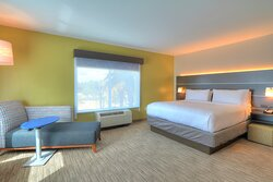 Jacuzzi Suites that features a King Bed and Chase Lounge Chair