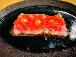 Shaved Tomato: layers of thinly sliced char siu and carpaccio beef, a bed of tobiko on top, and shaoxing wine reduction droplets.