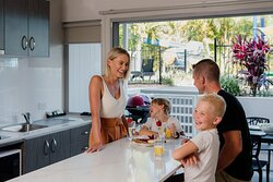 Family time is full of laughs in a Poolside Penthouse at Nobby Beach Holiday Village