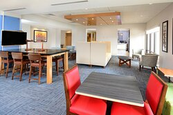 Our hotel near RDU offers a spacious and modern lobby to relax in.