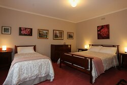 Suite 1 - The bedroom contains a queen and sin gel bed.