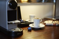 We provide a personal Nespresso in every room