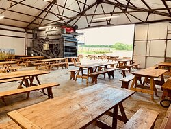 The Hop Hangar is used for the Hogs Back Tap 11 months of the year and for harvesting the hops one month of the year.