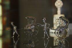 Miniature Chinese figurines.