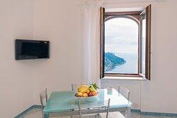zona giorno - bilocale con vista Costa D'Amalfi