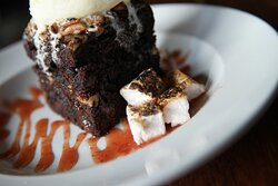 Spirits Signature brownie with housemade marshmallows and raspberry coulis