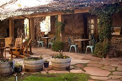 The beautiful and private courtyard at pet friendly El Portal Sedona Hotel.