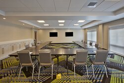 Very large meeting room with two televisions with HDMI hook up.