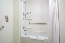 ADA Guest Bathroom with Grab Bars and Extended Shower Head