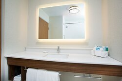 Well-Lit Guest Bathroom with Complimentary Toiletries