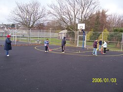 """Playing hockey in the tennis courts, with """"Aspects"""" on Tuesday 3rd January 2006."""
