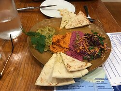 """Mezzo platter which was really just 3 dips on a plate with oil soaked 'eastern coleslaw"""""""