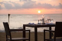 Private dining setup on the beach