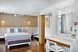 Interior view of bedroom in Avani Ocean View Pool Suite