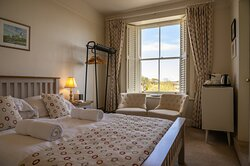 Coquet Room, located upstairs with countryside views and has a king-size double bed