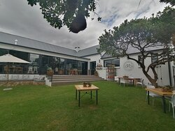 Coffee & Cream is located at the corner of Kerk and Keurboom Streets in Still Bay, a pleasant coastal town in the Western Cape along the famous Garden Route.