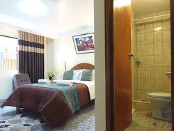 habitación matrimonial con baño privado agua caliente