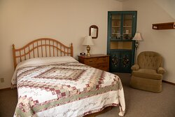 House in main rooms are furnished with antiques.  All of our rooms have queen-sized beds. See our website for ADA information.