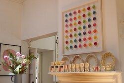 Hilary Nunan Rainbow Pod piece hanging and Mary Lincoln Handpainted range on mantlepiece