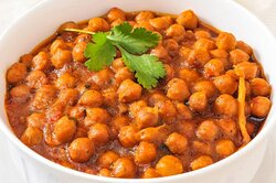 Channa Masala (GF)(V) Chickpeas cooked over a slow fire then blended with spices and tomatoes. A classic North Indian Specialty being served since the 1850′s.