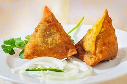Vegetable Samosa Potatoes mixed with vegetables, mild seasonings and wrapped in a light pastry