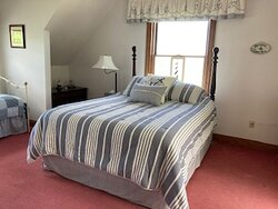 Captain's Quarters suite has a daybed, lake views, and private bath.