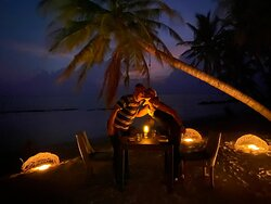 Image of the dining experiences at our guest house, Veli Beach Inn on Mathiveri in the Maldives.  All our meals are served buffet style, offering a variety of both traditional Maldivian cuisine and international cuisine throughout the day, with a variety of hot, soft drinks to keep you refreshed!!   Savour an exquisite intimate candlelit meal with your special someone beneath the stars.