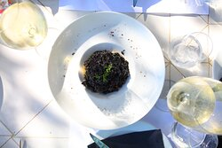 Black risotto - our version of the cuttlefish risotto. Traditional Croatian recipe with a twist. Perfectly paired with a glass of white wine.