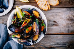 Moules mariniere and moules a la creme are on the spring Glasshouse menu