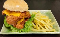 Crispy chicken sandwich with two breaded breast fillets and 2 slices of premium Cheese