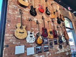 Autographed guitars on display in the restaurant.
