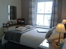Double en suite room with views over the rooftops to Skiddaw.  Welcome tray.
