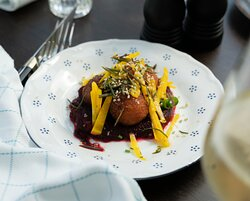 Fried Goat Cheese with floral honey, hemp seeds and beets