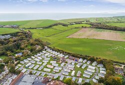 Aerial view of Downton Holiday Park out to sea