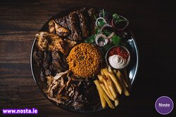 Niko's Plate for 2 or 4 people - Lamb skewer, chicken skewer, kofte skewers + lamb Doner & chicken Doner comes with Sauce, bread, salad and fries or rice.