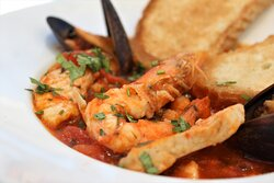 Our Signature Dish -  rich Seafood Soup featuring large shrimps, white fish and calamari