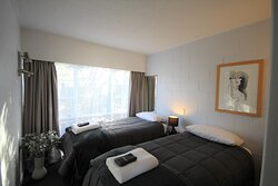 One bedroom unit has a queen in the living area and twin beds in the bedroom