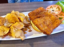 Fly Daddy Fish Sandwich (breaded cod topped with lettuce, tomatoes, dill pickles and house made tartar on a brioche bun)