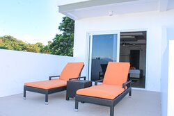 Our 𝗣𝗿𝗲𝗺𝗶𝘂𝗺 𝗦𝘂𝗶𝘁𝗲𝘀 are luxuriously appointed and have large external terraces with sun loungers, where you'll be able to enjoy views over our pool, or peerless views across the Verde Island channel.