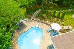 Heated outdoor pool and patio aerial view.