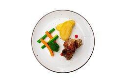 Lamb roasted with fresh herbs, potato fondant, mustard-rosemary sauce